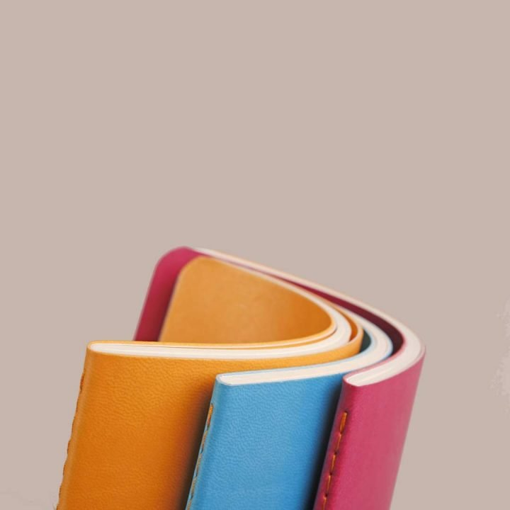 Rhodia Rhodiarama Sewn Spine Notebooks, curled covers to show flexibility