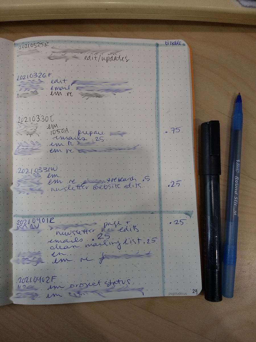 handwritten notebook page with some details blurred. it is an A5 dot notebook and there is a margin drawn in and entries are in a mix of blue and black ink. there is a marker and a blue ball point pen next to the page.